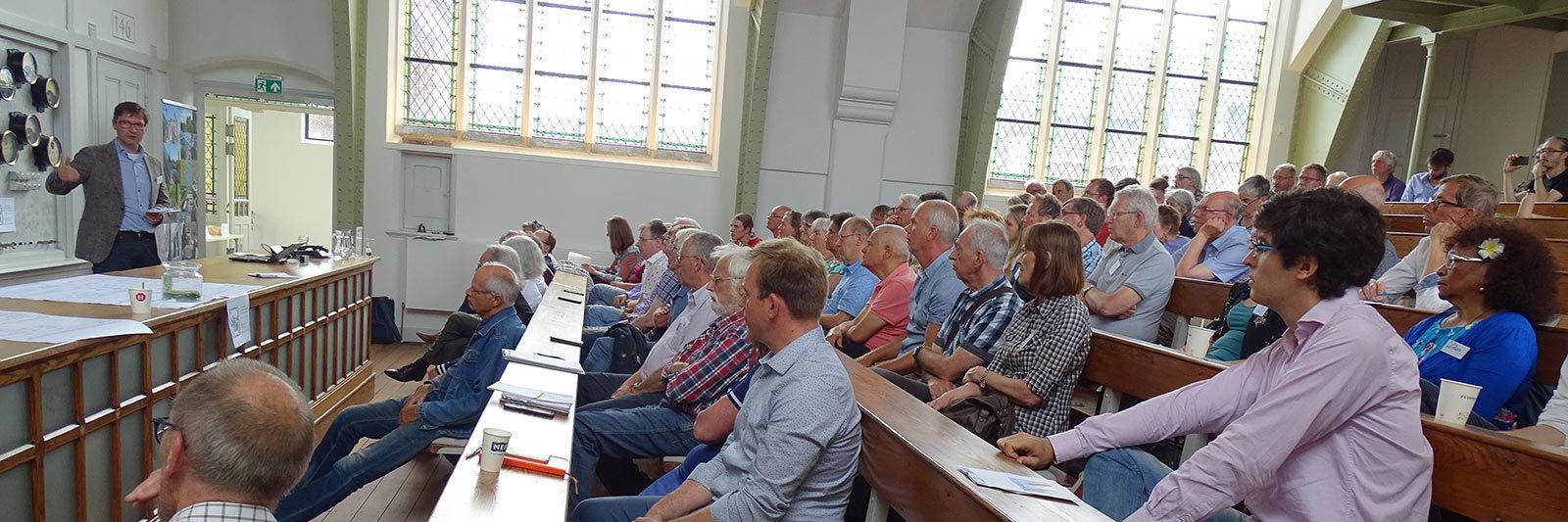 Wethouder Stephan Brandligt op het symposium